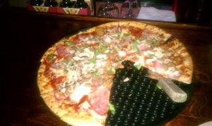 Photo of Carnivore Pizza at Rockin' Tomato in Austin, TX
